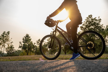 Image of woman early morning with riding bicycle outdoors.