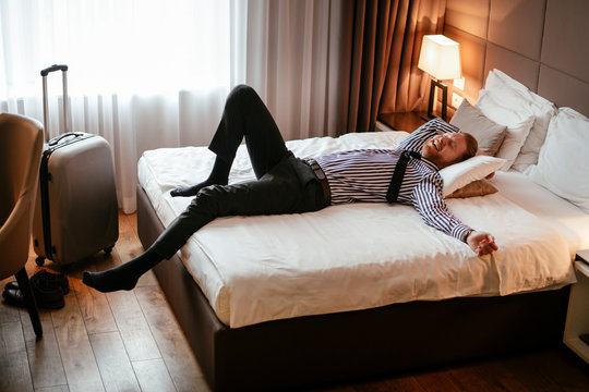 Manager rests after a long day. Boss relaxing at the hotel.