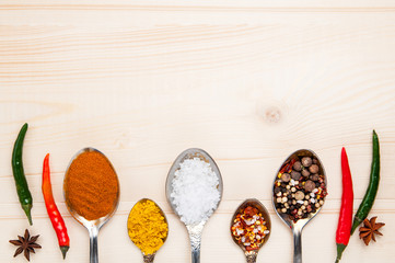 Set of seasonings and spices on wooden light background