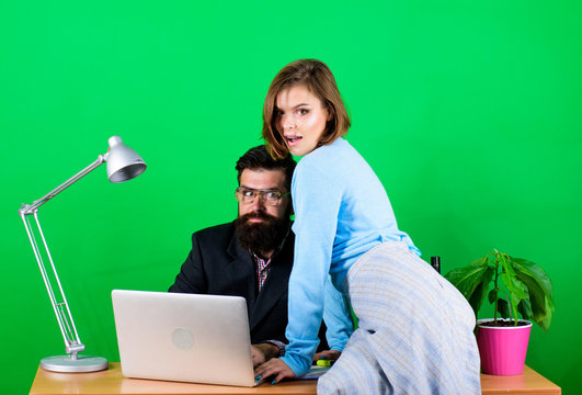 Combining their expertise. sexual harassment. data and information. businessman and assistant has problem. woman and man work in office. business couple at computer. secretary with boss at workplace