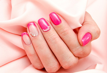 Woman's nails with beautiful manicure fashion design