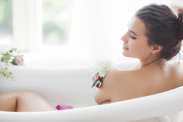 Obraz Perfact woman bathing with flowers and milk - fototapety do salonu
