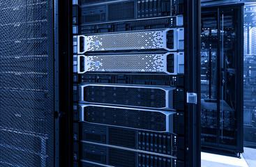 Server racks with mainframe disks cloud storage blue neon toning