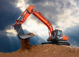 excavator works in construction site