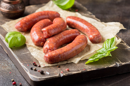 Raw grilled sausages with meat (beef, pork, lamb) and spices, hot merguez, kabanos, chorizo. Delicious food for picnic