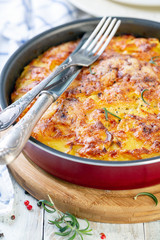 Potato slices baked with cheese. French cuisine.