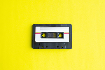 retro of tape cassette on yellow background. soft focus. Wall mural