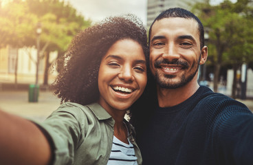 Beautiful happy couple taking selfie self-portrait