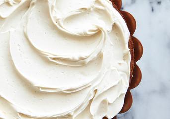 Cake with swirled vanilla frosting