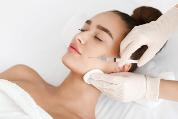 Plastic Surgery. Young Woman Receiving Botox Injection