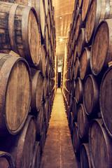 Fototapete - Detail of wine barrels stacked