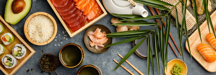 Overhead shot of ingredients for sushi on dark blue background Wall mural