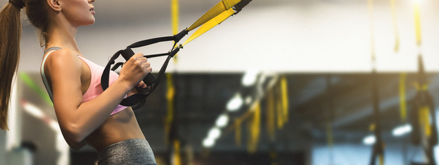 Trx training. Woman working out with fitness straps