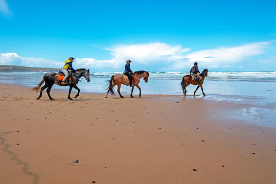 Horse riding at Carapateira beach in the Algarve Portugal