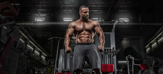 Brutal strong athletic men pumping up muscles workout bodybuilding concept background - muscular bodybuilder handsome men doing exercises in gym Wall mural