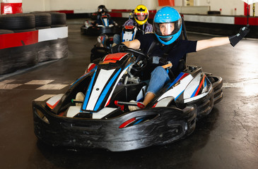 People driving go-kart cars