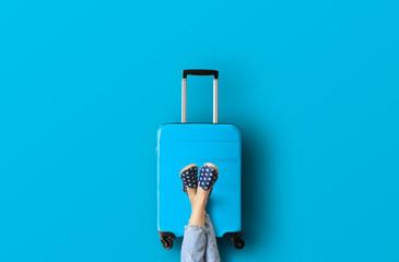Fototapeta Blue suitcase on the blue background obraz