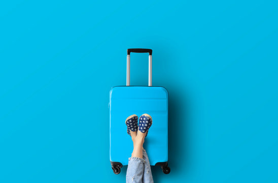 Blue suitcase on the blue background