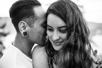 Intimate Photo of Man Whispering in Woman's Ear