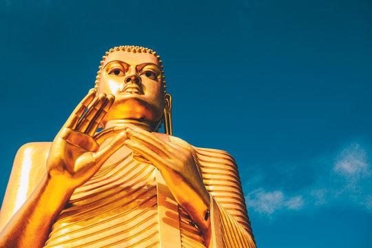 Giant golden Buddha statue
