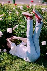 Girl having fun at peonies garden
