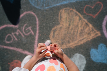 Little hands holding chalk