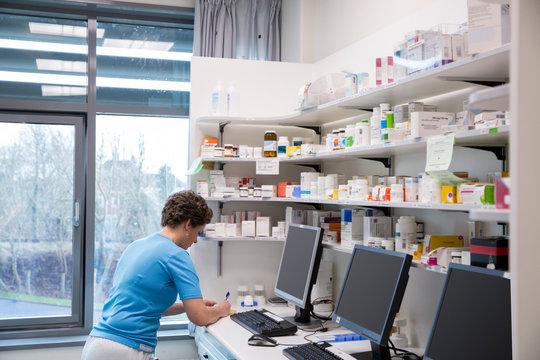 A nurse in a medication room