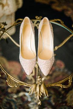 Elegant bridal shoes on stone fence