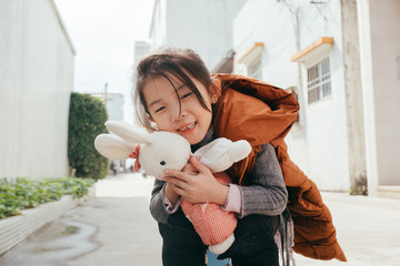 Asian little girl with a plush dools rabbit