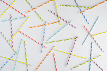 Colorful paper straws on white background