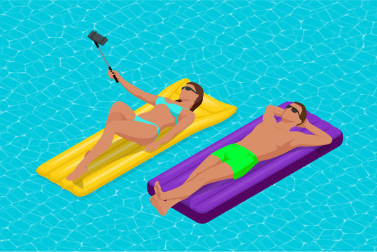 Inflatable ring and mattress. Young man nad woman on air mattress in the big swimming pool. Summer holiday idyllic. Enjoying suntan. Vacation concept. High view from above.
