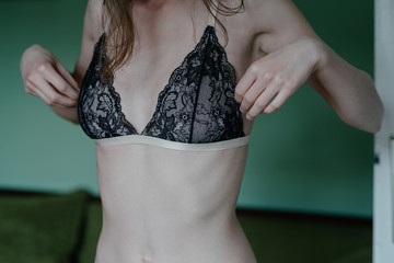 Close up of anonymous skinny female model in bra