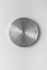 Metal clock on a white wall