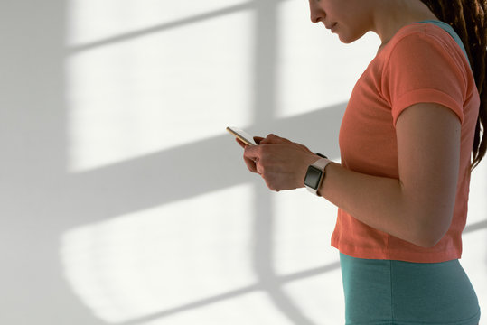 Woman using phone after workout
