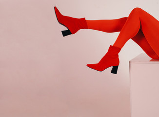 Legs of woman in red clothes