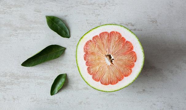 A top-down shot of a cut open grapefruit