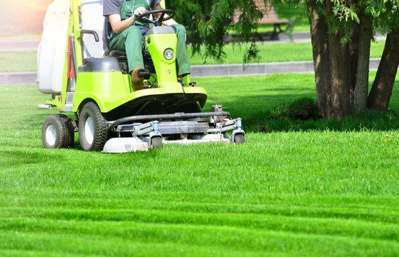 Lawn mower machine on a green lawn
