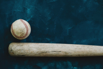 Baseball background with copy space by old used bat and ball.