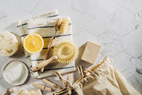 Eco friendly natural cleaning tools and products, bamboo dish brushes and lemon with baking soda. Zero waste concept. Plastic free.