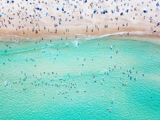 Bondi Beach aerial view on a perfect summer day with people swimming and sunbathing. Bondi is one of Sydney's busiest beaches and is located on the East Coast of Australia