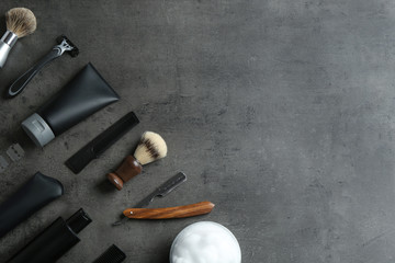 Flat lay composition with men's cosmetic products on grey background. Space for design