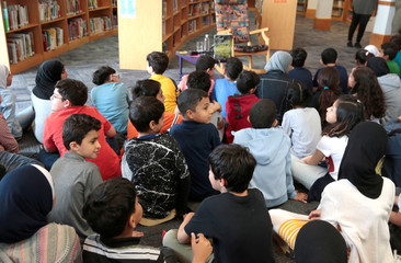 Students at Miller Elementary School sit and wait in the library for a visit from Senator Kamala Harris in Dearborn