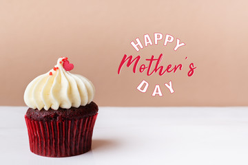 Happy Mothers Day, sweet red heart on white cream cupcake