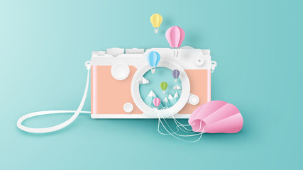 Creative design for camera with hot air balloons floating out of the camera lens. Abstract for camera with Hot air balloon festival. Hot air balloons festival. paper art style. vector, illustration.