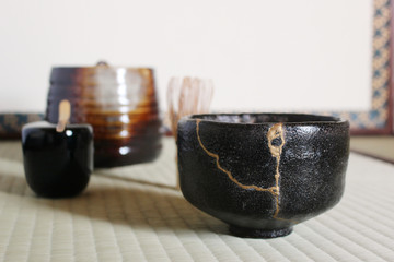 A repair of crack pottery tea cup  at Japanese tea room