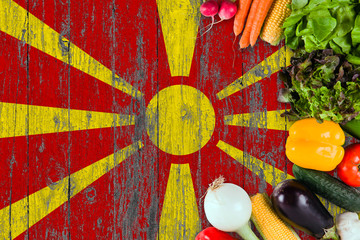 Fresh vegetables from Macedonia on table. Cooking concept on wooden flag background. Wall mural