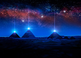 Sci-fi 3D rendering or illustration of Egyptian pyramids at night shooting light rays from the tips