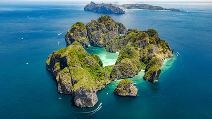 Aerial drone view of tropical Ko Phi Phi island, beaches and boats in blue clear Andaman sea water from above, beautiful archipelago islands of Krabi, Thailand Wall mural