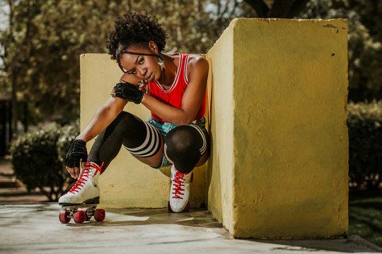 Beautiful black woman posing on roller skates