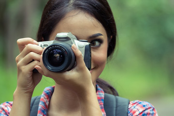 Asian woman taking photos with slr camera professional photography during her vacation